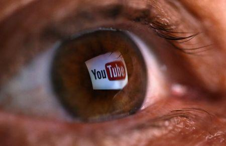 A picture illustration shows a YouTube logo reflected in a person's eye, in central Bosnian town of Zenica