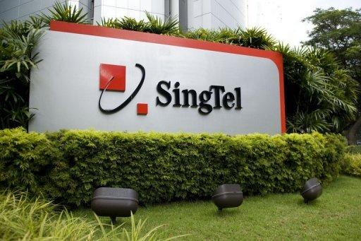 Singapore Telecom's net profit fell nearly 10 percent in its financial third quarter ended December 31