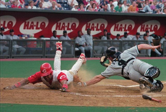 Cincinnati Reds' Barry Larkin is safe at home as Florida Marlins catcher Gregg Zaun makes the late tag May 14, 1998, in Cincinnati. (AP Photo/David Kohl)