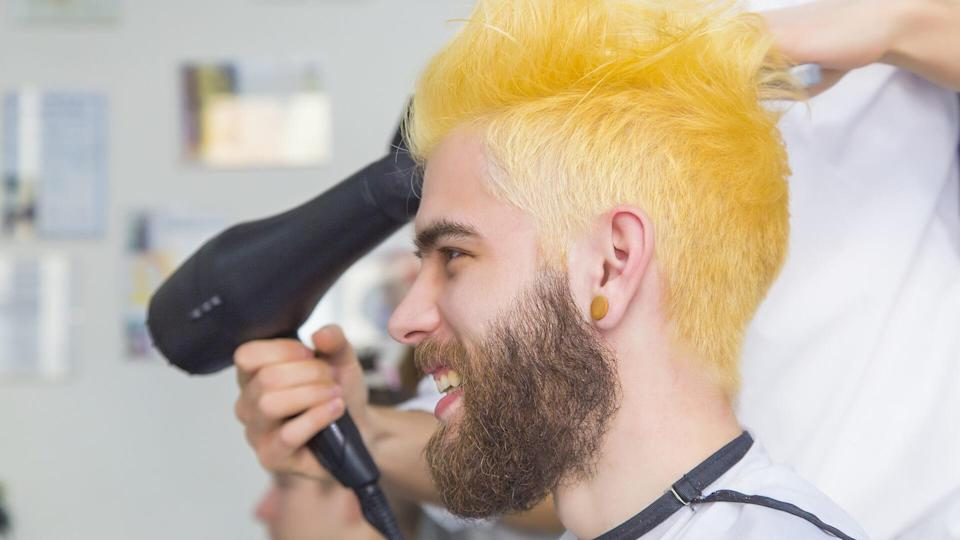In the making of a dyed blond hair for a bearded hipster guy.