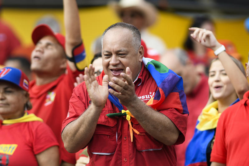 Socialist Party President Diosdado Cabello claps at a pro-government rally in Caracas, Venezuela, Saturday, Nov. 16, 2019. Crowds gathered in the Venezuelan's capital for rival demonstrations on Saturday. Opposition leader Juan Guaido called for Saturday's nationwide demonstrations to re-ignite a campaign against President Nicolas Maduro launched in January that has lost steam in recent months. (AP Photo/Matias Delacroix)