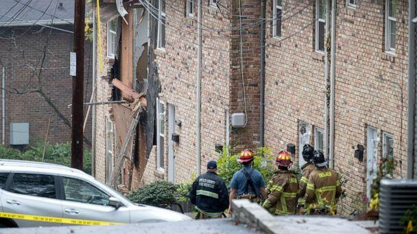 PHOTO: Fire officials look at the scene where an airplane crashed into an apartment complex, Wednesday, Oct. 30, 2019, in Atlanta. (David Goldman/AP)