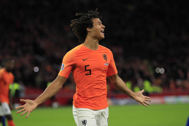 Netherlands' Nathan Ake celebrates scoring his side's second goal during the Euro 2020 group C qualifying soccer match between The Netherlands and Estonia at the Johan Cruyff ArenA in Amsterdam, Netherlands, Tuesday, Nov. 19, 2019. (AP Photo/Peter Dejong)