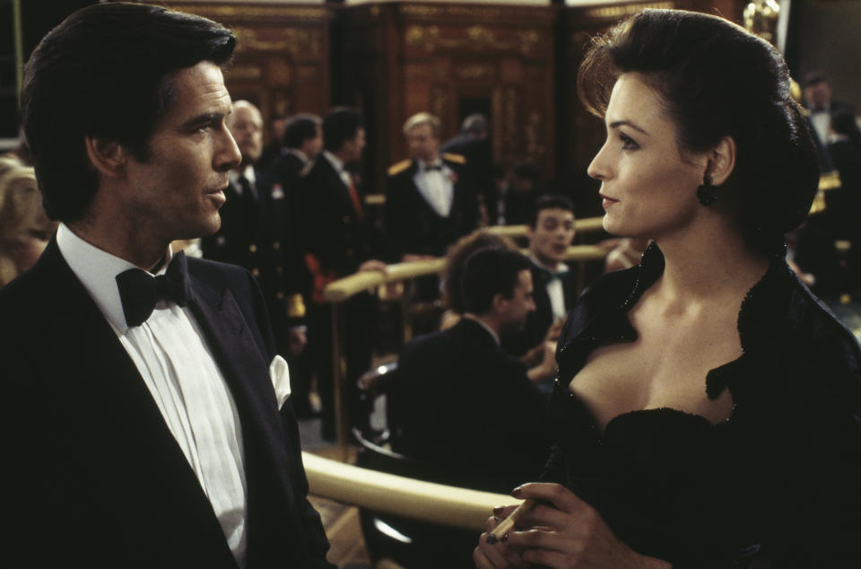 Irish actor Pierce Brosnan stars as James Bond alongside Dutch-born actress Famke Janssen as the villainous Xenia Onatopp in the film 'GoldenEye', 1995. Here they are filming a scene in the Casino de Monte Carlo, Monte Carlo, Monaco. (Photo by Keith Hamshere/Getty Images)