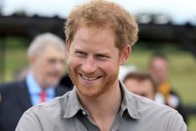 Watch Prince Harry's epic reaction after Japanese school kid calls him 'handsome'