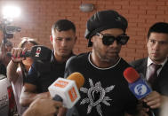 Former Brazilian soccer star Ronaldinho, or Ronaldo de Assis Moreira, enters Paraguay's attorney offices in Asuncion, Paraguay, Thursday, March 5, 2020. According to local news, Ronaldinho is accused of arriving in the country with a fake Paraguay passport. (AP Photo/Jorge Saenz)
