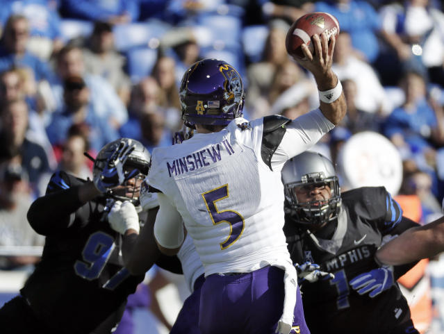 East Carolina quarterback Gardner Minshew (5) passes against Memphis in the first half of an NCAA college football game Saturday, Nov. 25, 2017, in Memphis, Tenn. (AP Photo/Mark Humphrey)