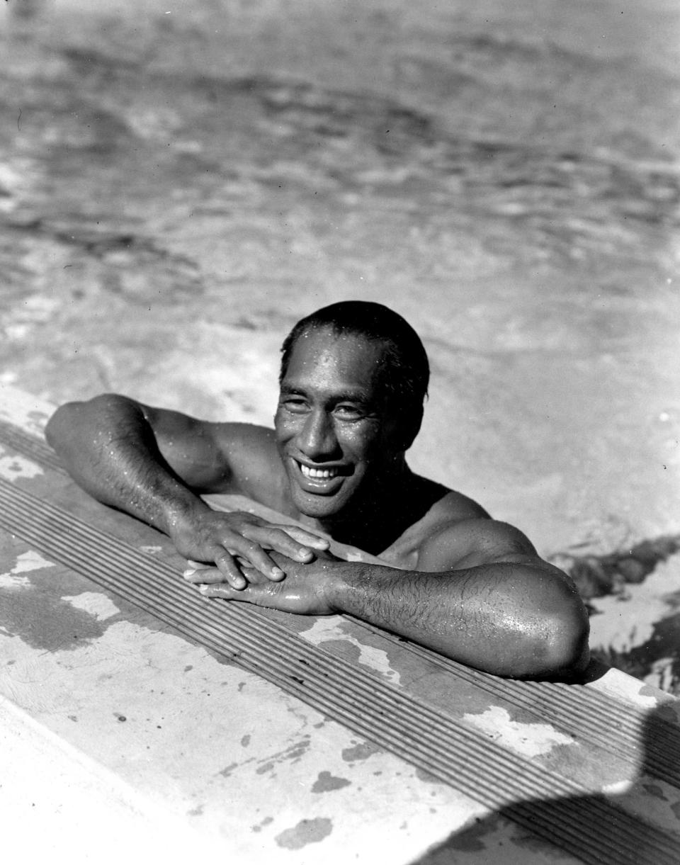 FILE - In this Aug. 11, 1933, file photo, Duke Kahanamoku, Hawaiian Olympic swimmer, poses in a swimming pool in Los Angeles. For some Native Hawaiians, surfing's Olympic debut is both a celebration of a cultural touchstone invented by their ancestors, and an extension of the racial indignities seared into the history of the game and their homeland. Kahanamoku was a Native Hawaiian swimmer who won five Olympic medals and is known as the godfather of modern surfing who introduced the sport in surfing exhibitions in Australia and California. (AP Photo/File)