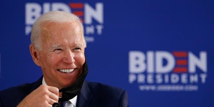 Democratic presidential candidate former Vice President Joe Biden smiles while speaking during a roundtable on economic reopening with community members, Thursday, June 11, 2020, in Philadelphia. (AP Photo/Matt Slocum)