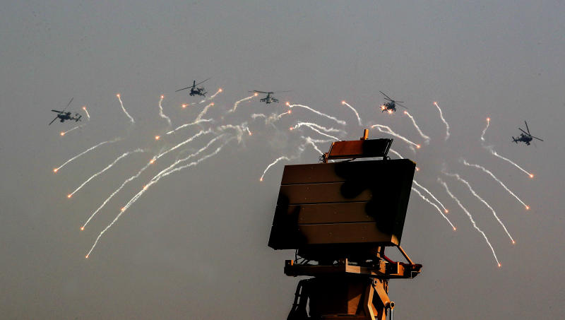 Indian Air Force Apache helicopters fire flares during Air Force Day parade at Hindon Air Force Station on the outskirts of New Delhi, India, Thursday, Oct. 8, 2020. (AP Photo/Manish Swarup)