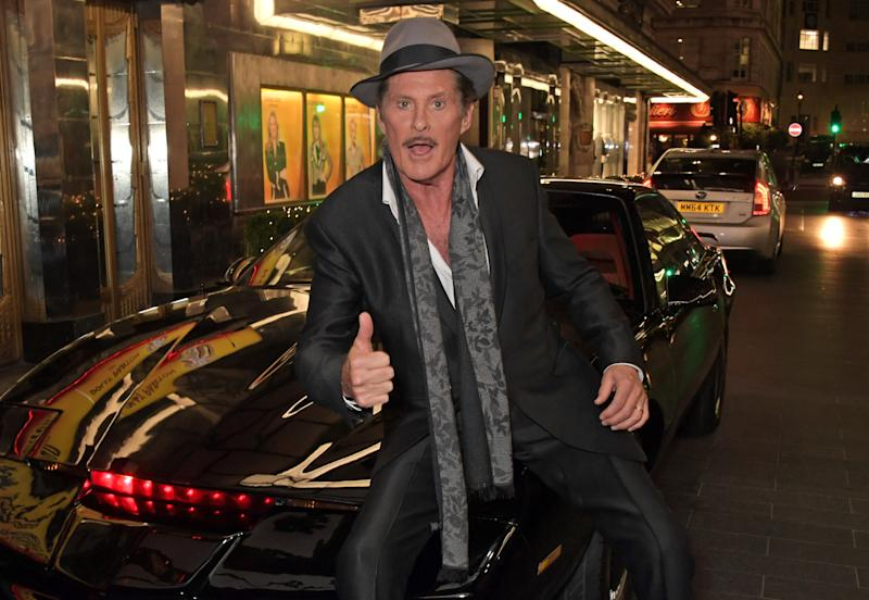 """LONDON, ENGLAND - DECEMBER 11: David Hasselhoff poses with KITT from Knight Rider at the gala party to celebrate David Hasselhoff joining the cast of the West End production of """"9 To 5: The Musical"""" at The Savoy Theatre on December 11, 2019 in London, England. (Photo by David M. Benett/Dave Benett/Getty Images)"""