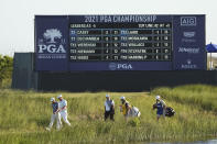 Hideki Matsuyama, center, of Japan, center, walks with his caddie as Bryson DeChambeau, second from left, and Collin Morikawa, left, lead the way to the 17th hole during the second round of the PGA Championship golf tournament on the Ocean Course Friday, May 21, 2021, in Kiawah Island, S.C. (AP Photo/David J. Phillip)