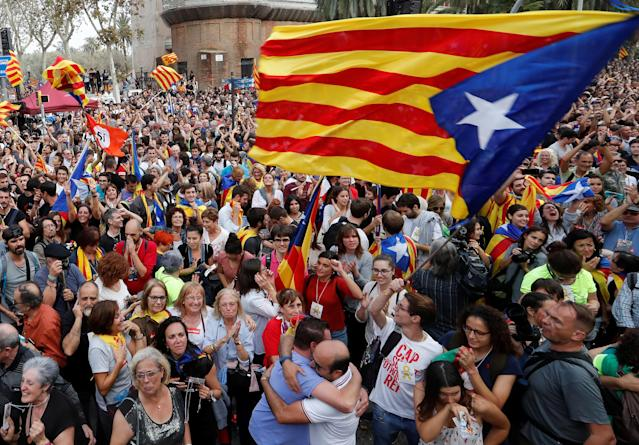 <p>People celebrate after the Catalan regional parliament passes the vote of independence from Spain in Barcelona, Spain, Oct. 27, 2017. (Photo: Yves Herman/Reuters) </p>