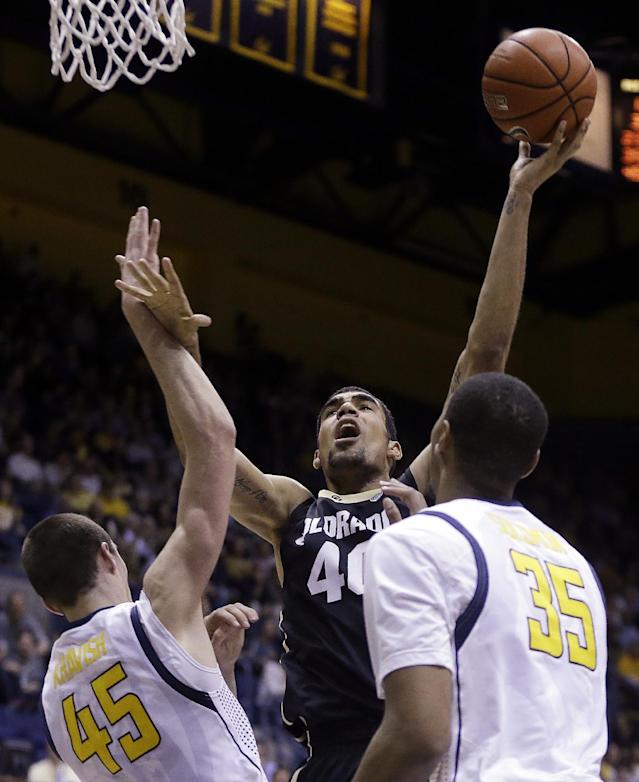Colorado's Josh Scott (40) shoots between California's David Kravish, left, and Richard Solomon (35) in the first half of an NCAA college basketball game on Saturday, March 8, 2014, in Berkeley, Calif. (AP Photo/Ben Margot)