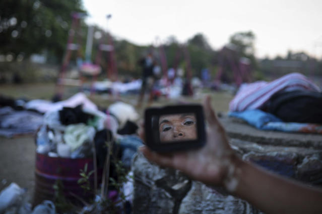 "<p>A woman is reflected in a mirror as she gets ready for the day, as Central American migrants traveling with the annual ""Stations of the Cross"" caravan wake up at a sports club in Matias Romero, Oaxaca State, Mexico, uesday, April 3, 2018. The caravan of Central American migrants that angered U.S. President Donald Trump was sidelined at a sports field in southern Mexico with no means of reaching the border even as Trump tweeted another threat to Mexico Tuesday.(Photo: Felix Marquez/AP) </p>"