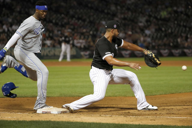 Kansas City Royals' Jorge Soler, left, reaches first as Chicago White Sox first baseman Jose Abreu is unable to handle a throw from third baseman Yoan Moncada during the seventh inning of a baseball game Wednesday, Sept. 11, 2019, in Chicago. (AP Photo/Charles Rex Arbogast)