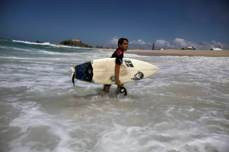 Rickson Falcao, 10, who spends half of every day riding the waves, dreams of becoming world surfing champion