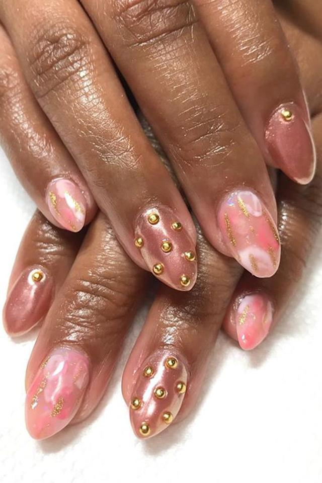 """<p>The key to pulling off this trend is pairing studs with soft, feminine rose gold nails.</p><p><strong>See more at <a rel=""""nofollow"""" href=""""https://www.instagram.com/fleuryrosenails/"""">Fleury Rose</a>. </strong></p>"""
