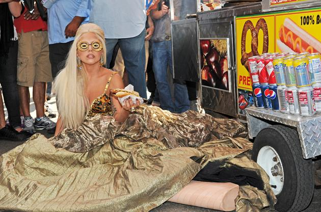 Lady Gaga took to the streets of New York for a phot oshoot with Annie Leibovitz. She posed in a ball gown, on the floor, clutching a hot-dog. Standard Lady Gaga then.
