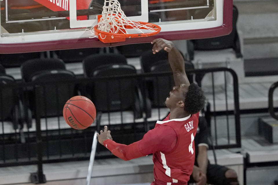 Alabama forward Juwan Gary (4) celebrates his uncontested dunk during the first half of an NCAA college basketball game against Mississippi State in Starkville, Miss., Saturday, Feb. 27, 2021. (AP Photo/Rogelio V. Solis)