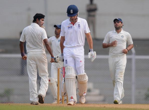 MUMBAI, INDIA - NOVEMBER 01:  Ashok Dinda of India 'A' (L) looks on after taking the wicket of  Alastair Cook captian of England (C), as the latter walks back  during the final day of the first practice match between England and India 'A' at the CCI (Cricket Club of India) ground, on November 1, 2012 in Mumbai, India.  (Photo by Pal Pillai/Getty Images)