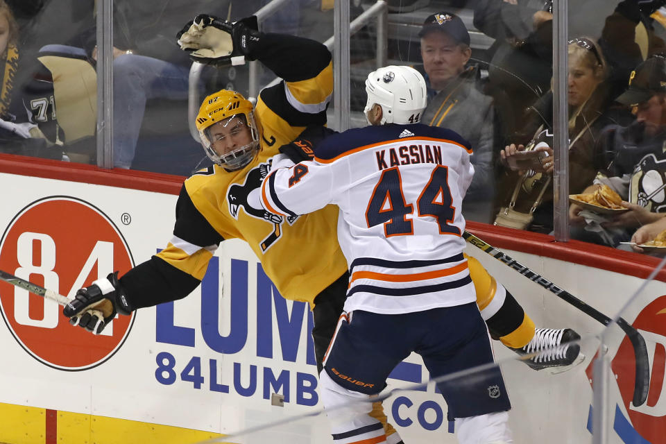 Pittsburgh Penguins' Sidney Crosby (87) is checked off his skates by Edmonton Oilers' Zack Kassian (44) during the first period of an NHL hockey game in Pittsburgh, Saturday, Nov. 2, 2019. (AP Photo/Gene J. Puskar)