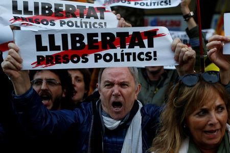 Protesters take part in a demonstration called by pro-independence asociations asking for the release of jailed Catalan activists and leaders, in Barcelona