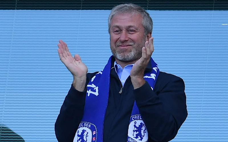 Chelsea's Russian owner Roman Abramovich applauds, as players celebrate their league title win at the end of the Premier League football match between Chelsea and Sunderland at Stamford Bridge in London. - AFP