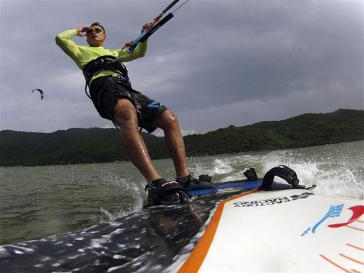 """Jay Chau, vice chairman of the Hong Kong Kiteboarding Federation, takes part in a training session at Shui Hau Wan at Hong Kong's Lantau Island May 12, 2012. The International Sailing Federation (ISAF) announced the decision to include men's and women's kiteboarding at the expense of windsurfing earlier this month, describing it as a """"fantastic addition"""" for the Games in Rio de Janeiro."""