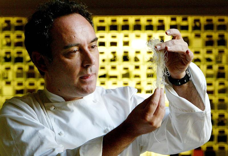 FILE - In this Dec. 5, 2003 file photo, Spanish chef Ferran Adria examines ingredients in his kitchen workshop in Barcelona, Spain. Spanish chef Ferran Adria, the man behind the late, lamented elBulli restaurant, is bringing an exhibition dedicated to the art and science of his experimental brand of cooking to London. The show, which was visited by 650,000 people during a year-long run in Barcelona, will be on display from July 5 to Sept. 29, 2013 at London's Somerset House. (AP Photo/Bernat Armangue, File)