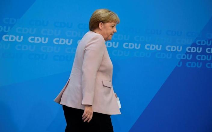 For Merkel, an election debacle for either her CDU or junior coalition partner the SPD would pose another threat to their uneasy coalition (AFP Photo/Tobias SCHWARZ)