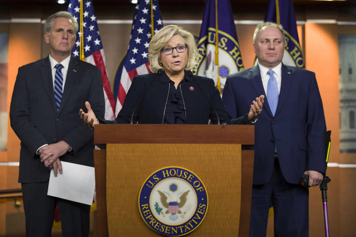 House Republican Conference chair Rep. Liz Cheney, R-Wyo., center, accompanied by House Minority Leader Kevin McCarthy of Calif., left, and House Minority Whip Steve Scalise of La., speaks at a news conference on Capitol Hill, Tuesday, Jan. 15, 2019 in Washington. (AP Photo/Alex Brandon)