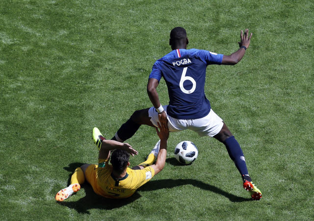 France's Paul Pogba, right, duels for the ball with Australia's Mathew Leckie during the group C match between France and Australia at the 2018 soccer World Cup in the Kazan Arena in Kazan, Russia, Saturday, June 16, 2018. (AP Photo/Hassan Ammar)