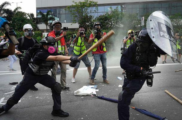 PHOTO: Police and demonstrators clash during a protest in Hong Kong, Saturday, Aug. 24, 2019. (Vincent Yu/AP)