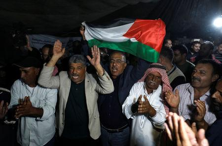 People celebrate after Israel delays eviction of the Palestinian Bedouin village of Khan al-Ahmar, in the occupied West Bank October 20, 2018. REUTERS/Mohamad Torokman