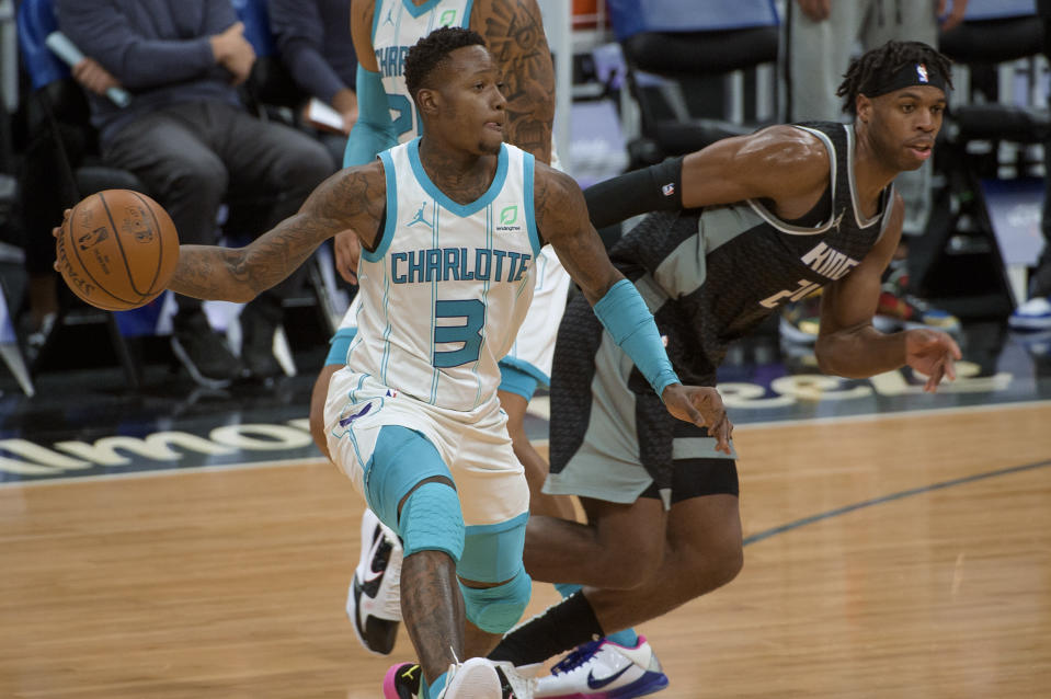 Charlotte Hornets guard Terry Rozier (3) passes the ball as Sacramento Kings guard Buddy Hield (24) defends during the second half of an NBA basketball game in Sacramento, Calif., Sunday, Feb. 28, 2021. The Hornets won 127-126. (AP Photo/Randall Benton)