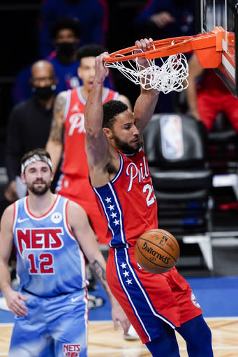 Philadelphia 76ers' Ben Simmons dunks in front of Brooklyn Nets' Joe Harris during the first half of an NBA basketball game Thursday, Jan. 7, 2021, in New York. (AP Photo/Frank Franklin II)
