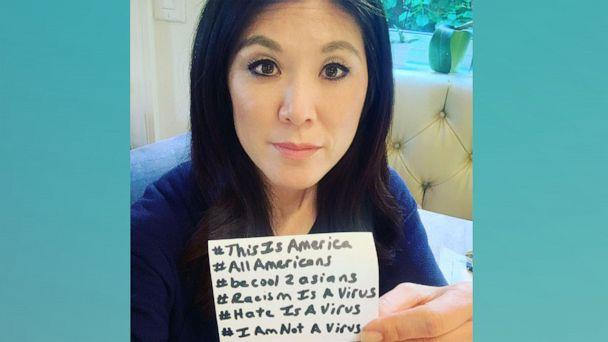 PHOTO: Journalist Nydia Han holds up several hashtags used to bring awareness to Asian American discrimination. (Nydia Han)