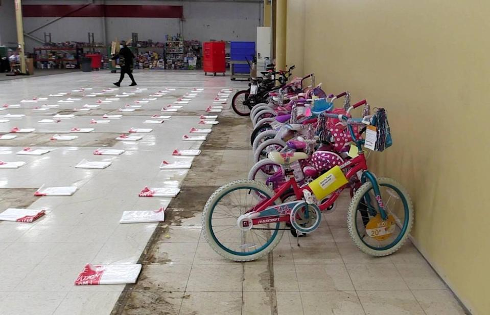 Bicycles and gift bags are arranged on the floor at The Salvation Army's Christmas Center on Nov. 19, 2020, for its angel tree program, which matches children in need with anonymous donors who buy the gifts. The Charlotte Observer is holding its annual Empty Stocking Fund campaign to raise money for gifts in cases where there were no donations or gifts were not returned.