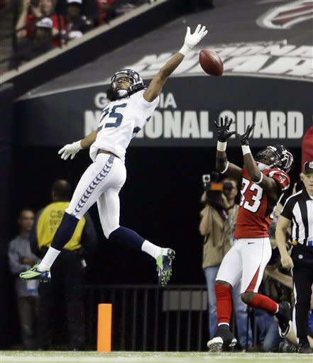 Seattle Seahawks cornerback Richard Sherman (25) breaks up a pass intended Atlanta Falcons wide receiver Harry Douglas (83) during the second half of an NFC divisional playoff NFL football game Sunday, Jan. 13, 2013, in Atlanta. (AP Photo/David Goldman)
