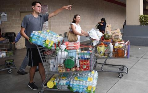 Shoppers at Costco waited up to eight hours for water and essentials in preparation for Hurricane Irma on September 5, 2017 in North Miami. - Credit: MICHELE EVE SANDBERG/AFP