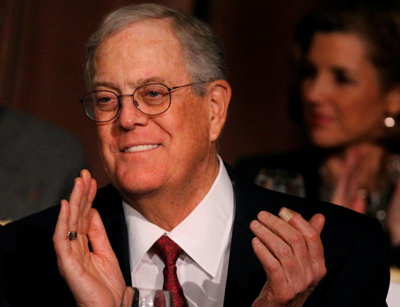 David Koch, executive vice president of Koch Industries, applauds during an Economic Club of New York event in New York, December 10, 2012. REUTERS/Brendan McDermid/File Photo - RC1FF78C3D30