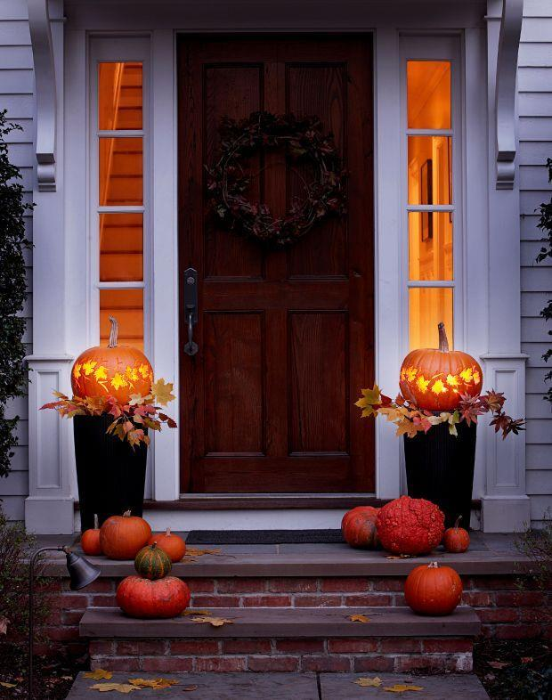 """<p>Mimic the fall foliage outside with our easy pumpkin carving template. Plop the glowing lanterns atop a pair of planters to welcome trick-or-treaters. </p><p><em><a href=""""https://www.goodhousekeeping.com/holidays/halloween-ideas/a24856/pumpkin-lanterns/"""" rel=""""nofollow noopener"""" target=""""_blank"""" data-ylk=""""slk:Get the tutorial for Leafy Garland Pumpkin »"""" class=""""link rapid-noclick-resp"""">Get the tutorial for Leafy Garland Pumpkin »</a></em> </p>"""