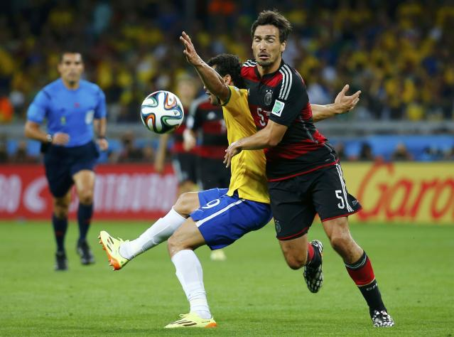 Brazil's Fred (L) fights for the ball with Germany's Mats Hummels during their 2014 World Cup semi-finals at the Mineirao stadium in Belo Horizonte July 8, 2014. REUTERS/Kai Pfaffenbach (BRAZIL - Tags: SOCCER SPORT WORLD CUP)