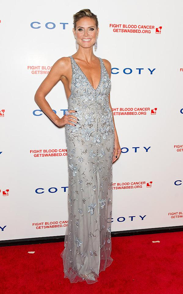 """Heidi Klum has delivered a few misfires on the red carpet since her split from Seal, but she redeemed herself at a recent blood cancer benefit in NYC. The """"Project Runway"""" hostess with the mostest oozed elegance in a bedazzled, plunging Temperley London dress, chic updo, and smokey eyes. (4/26/2012)"""