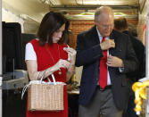 """Former Mississippi Supreme Court Chief Justice Bill Waller Jr., a candidate for the GOP nomination for governor, right, and his wife Charlotte Waller, put their """"I voted"""" stickers on their clothes as they exit their north Jackson, Miss., precinct, Tuesday, Aug. 27, 2019. Waller faces Lt. Governor Tate Reeves in the runoff for the GOP nomination for governor. (AP Photo/Rogelio V. Solis)"""