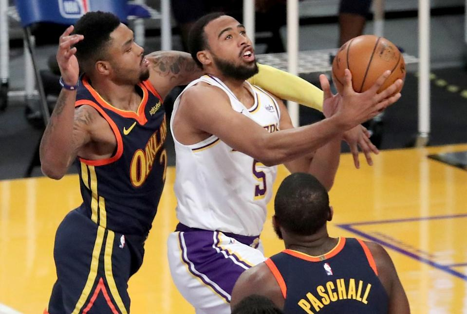 Lakers guard Talen Horton-Tucker is fouled by Golden State Warriors guard Kent Bazemore.