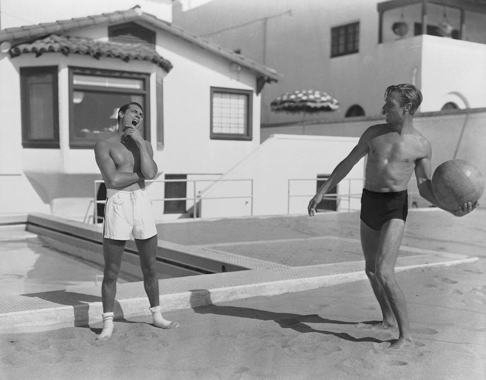 <p>Randolph Scott and Cary Grant play with a ball at their shared beach house in 1935. </p>