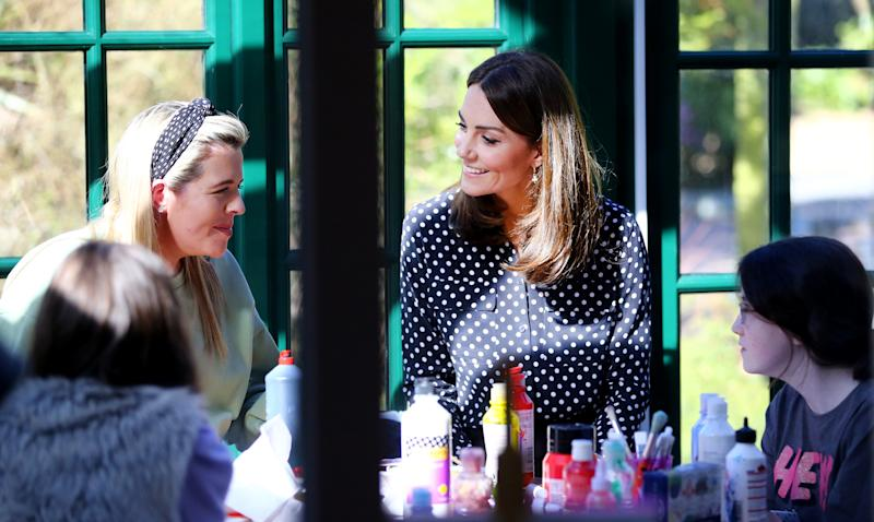 The Duchess of Cambridge speaking with members and staff at an arts and crafts area in the centre during a visit to Extern at Savannah House, in County Meath, near Dublin, as part of her three day visit to the Republic of Ireland.