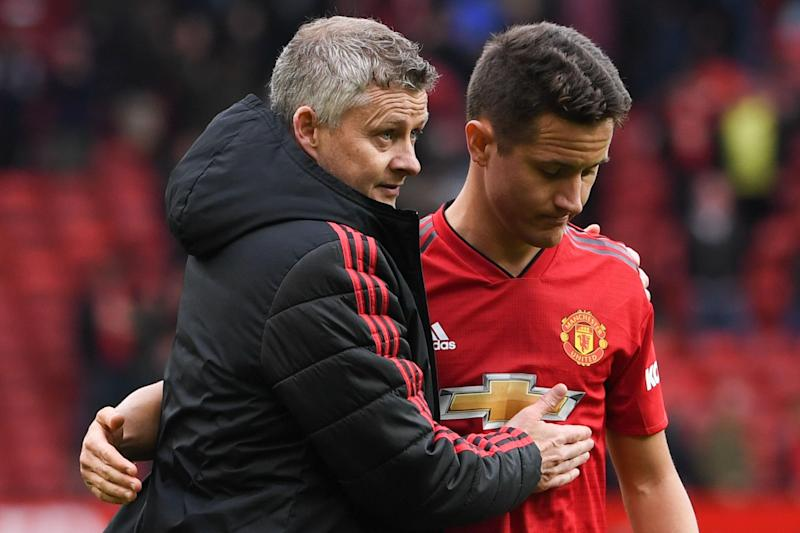 Manchester United's Norwegian manager Ole Gunnar Solskjaer (L) puts an arm around Manchester United's Spanish midfielder Ander Herrera (R) at the end of the English Premier League football match between Manchester United and Chelsea at Old Trafford in Manchester, north west England, on April 28, 2019. (Photo by Paul ELLIS / AFP) / RESTRICTED TO EDITORIAL USE. No use with unauthorized audio, video, data, fixture lists, club/league logos or 'live' services. Online in-match use limited to 120 images. An additional 40 images may be used in extra time. No video emulation. Social media in-match use limited to 120 images. An additional 40 images may be used in extra time. No use in betting publications, games or single club/league/player publications. / (Photo credit should read PAUL ELLIS/AFP via Getty Images)